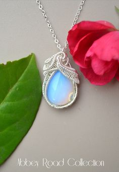 Opalite Silver Pear Wire Wrapped Pendant.