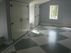 an inexpensive solution: how to paint checkerboard floors. Click the link for the how-to. This is our future boys' room.