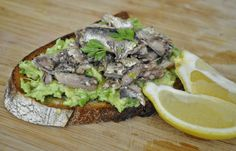 Alton Brown's Sardine Avocado Sandwich: 2 cans sardines in oil drained into bowl, whisk oil with 1 Tbsp lemon, 1 avocado smashed and spread onto 2-3 pieces good quality toasted bread.  Top with smashed sardines.  Drizzles with oil and top with optional salt/pepper/fresh parsley.  YUM!