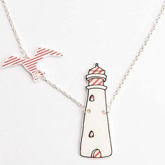 £15 Lighthouse and Seagull In Flight Necklace