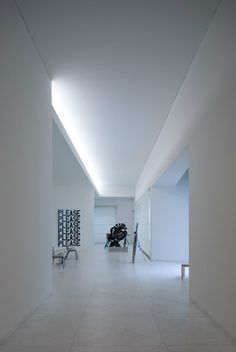 Corridor inside the Fundacao Servalles in Porto by Portugese architect Alvaro Siza. Photo by Fernando Guerra.