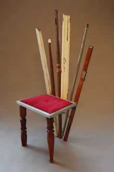 salvaged wooden chair. salvage wood used for legs and back, welded seat frame and upholstered cushion. by Kayla Abe