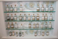 Great way to display bottles of sand from trips -- find map of Caribbean!