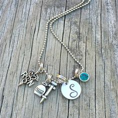 Show your FAVORITE RN / Registered Nurse / Nurse Practitioner how much you love them with this super cute necklace (stainless steel ball chain)!