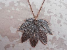DOCTOR WHO CLARA OSWALD LEAF NECKLACE, MADE BY MYSELF, LEAF IS COPPER-PLATED AND MEASURES 50 X 40MM, IS HANGING ON A 20 IN COPPER-PLATED CHAIN.