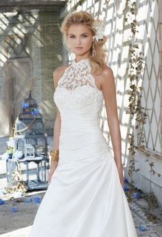 gorgeous satin wedding dress with a shirred bodice bearing a sweetheart neckline and a beaded lace and illusion halter that settles over the top portion of the bodice.  The A-line silhouette is slimming and the beaded lace halter gives it just enough embellishments delicately.
