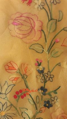 Motif details of the shadow embroidered geogette saree.