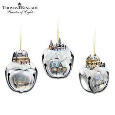 Thomas Kinkade Christmas Art Jingle Sleigh Bell Ornaments. Actual jingle bells feature sculptural Kinkade scene on the top, faithfully reproduced Kinkade artwork on the smooth silvertone sides. #DeckTheHalls