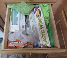 Day 22: Wrap drawer. Before. Too much stuff! @Becky_ Organizing Made Fun™ #spontaneousorganizing