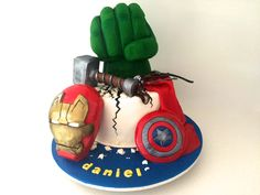 Today we are making a Marvel Avengers cake with Iron Man's mask, Thor's hammer, Captain America's shield, Hawk Eye's bow and arrow and of course Hulk's fist smashing through the top of the cake. HULK SMASH! This cake went to a birthday party that was held at a public venue and had passers by of all ages stopping to stare and admire the cake. To make this Marvel Avengers Cake you will need: Serves: I
