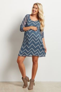This pretty chevron print plus size maternity dress is perfect for those warm days where you need something light and fun to wear. Cinching under the bust creates a flattering silhouette perfect for transitional moms. Wear this maternity dress with your favorite boots or flats for a complete look!