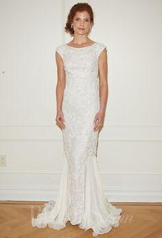 "Brides.com: Randi Rahm - Fall 2014. ""Ryan"" beaded sheath wedding dress with bateau neckline, cap sleeves, and silk panels on skirt, Randi Rahm"