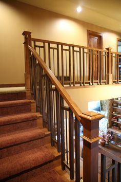 Stair Systems | craftsman style stair case with a mix of wood and wrought iron |