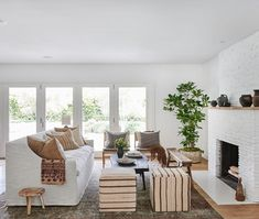 modern boho living room with painted white brick fireplace and boho pillows fid Boho Living Room, Home And Living, Living Room Decor, Living Spaces, Slow Living, Pouf Design, Bathroom Vanity Decor, Remodel Bathroom, Vintage Dining Chairs