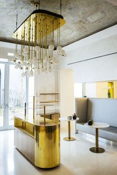 Stunning lighting fixtures in gold and white hotel interior