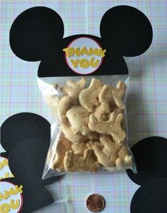 Pinning this because I want to do frosted animal crackers for maci's party but not mickey mouse. Same idea, completely different packaging.