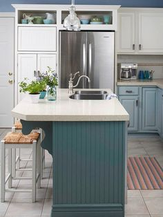 Painted Kitchen Islands (Better Homes & Gardens) - blue cabinets, display space over refrigerator