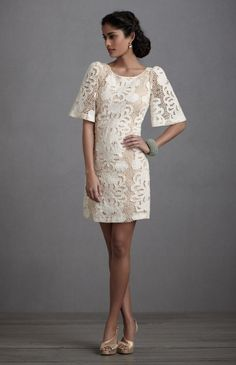 Reception dress in floral lace..