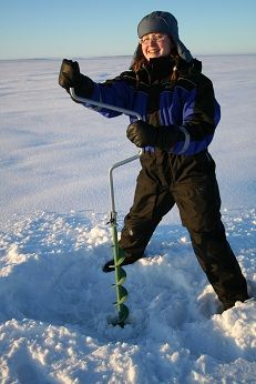 Ice fishing on the ice oF Bothnic Sea.