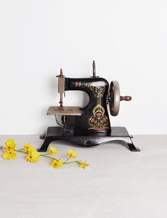 Vintage Casige Toy Sewing Machine - art nouveau design - made in Germany. Children's miniature toy.