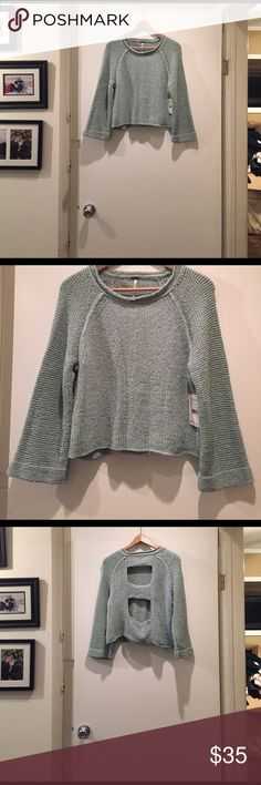 Free People Open Back Crop Sweater Beautiful sea spray colored scoop neck sweater with slight bell sleeves. Open back detail. Knit construction. Approximately 20 inches long. 66 percent cotton/34percent nylon. Dry clean or hand wash cold. Free People Sweaters Crew & Scoop Necks