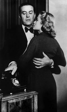 """Grace Kelly and Ray Milland in Alfred Hitchcock's """"Dial M for Murder."""" 1954. An ex-tennis pro carries out a plot to murder his wife. When things go wrong, he improvises a brilliant plan B."""