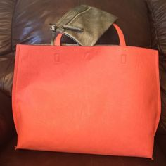 """Reversible Coral/Pewter Tote Reversible Coral/ Pewter Tote, removable coin purse, snap top closure. No rips, wear or tears. Approx 19""""Lx6""""Wx13-1/2""""H Still has tags, really beautiful bag. Bags"""