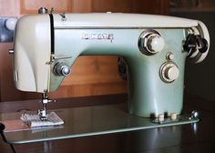 """I'm told this is the machine my Grandma did most of her sewing on (home projects, clothing, quilting, embroidery). My Dad had it serviced to working order a few years ago """"just in case"""". Last time I visited I took a few"""
