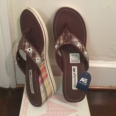 American Eagle brown thong sandal These shoes are brand new with tag. Only tried on to model in. Size 6.5. Come with box great condition, smoke free home. American Eagle by Payless Shoes Sandals