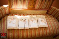 Elizabeth + Patrick's Wedding at Lenora's Legacy. Photo credit: Cureton Photography Bridal gifts on a sofa.
