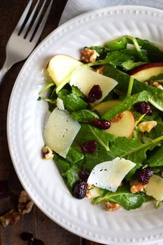 This Apple Pear Salad with a Honey Cilantro Vinaigrette is an easy 5 minute recipe made with crunchy apples, sliced pears, dried cranberries, walnuts and shaved Manchego cheese. (gluten free, low carb, paleo, vegetarian)