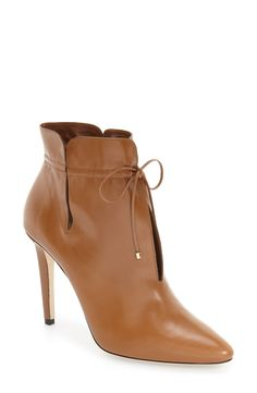 Slender cutouts and a bow further the appeal of this chic and sophisticated bootie crafted from Italian leather.