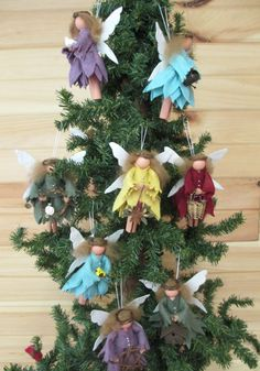 These handmade woodland faeries are created from a clothespin, wood ball, pipe cleaner and scraps of wool and wool felt. Butterfly-like wings are made from Antique White wool felt spritzed with A loop of heavy embroidery thread serves as the hanger. Each fairy may be holding a different item - such as a bird, wreath, candle or birdhouse. Make your personal selection of each when ordering, or choose No Preference for a random selection.  Use them as Christmas Ornaments, gift package…