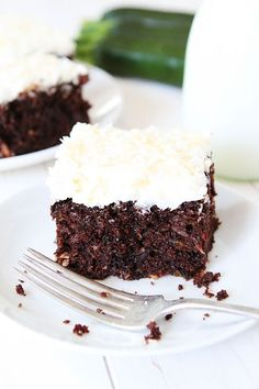 Chocolate Zucchini Coconut Cake Recipe on twopeasandtheirpod.com The BEST zucchini cake recipe! #zucchini #chocolate #cake