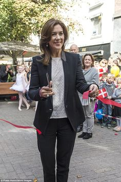 Cutting the ribbon: Wearing a smart suit Princess Mary attended the event as a part of her...