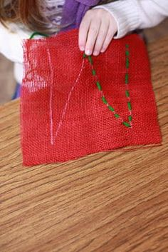 teaching to sew... cute idea for a child to make for someone.