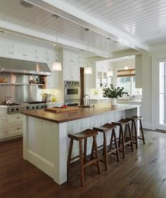 Modern cottage kitchen with glossy white beadboard ceiling and white box beams. White wood paneled center island with butcher block countertop and sawhorse counter stools. Love the chocolate wood kitchen design interior design ideas design New Kitchen, Kitchen Decor, Kitchen Ideas, Kitchen Designs, Kitchen Layout, Kitchen Photos, Long Kitchen, Kitchen White, Kitchen Inspiration