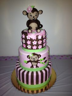 Monkey girl baby shower cake!  This is a popular baby shower theme. We love how this three tier cake goes perfectly with the colors and theme!