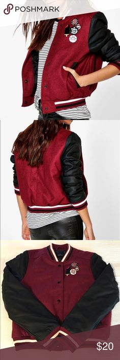 NWT Varsity Jacket! Black and maroon varsity styled jacket! U.K. Size 14 which is US size 10. Black faux leather sleeves. Never worn NWT! Boohoo Jackets & Coats
