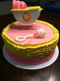 Baby girl baby shower cake with pink and yellow buttercream ruffles. Made by Tay's Treats. Facebook.com/taystreats