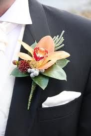 Boutonniere is attached by pinning it near the heart of the groom on his left lapel.