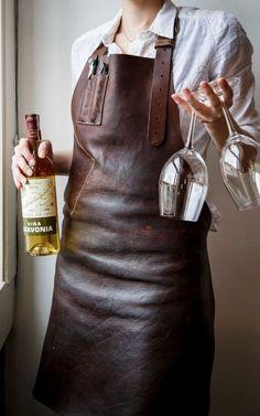 Staffers at Oxheart restaurant wear leather aprons designed by Houston leatherworker Kyle Kubin.