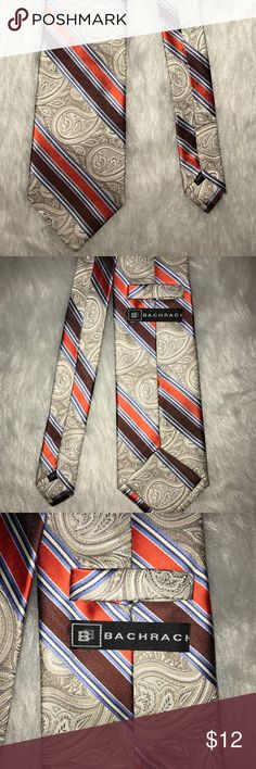 100% Silk Bachrach Paisley Gray Tie 100% Silk Bachrach Paisley Gray Tie with Orange, Maroon, and Blue Accents. Very unique and ultra stylish. Excellent craftsmanship and value. Bachrach Accessories Ties