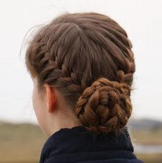 two braids and a low braided bun updo