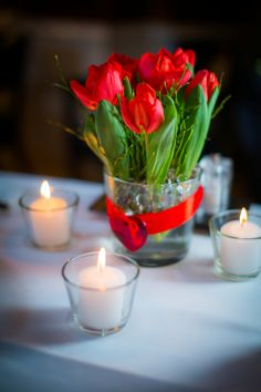 Romantic red Tulips with candles and heart shapes. Perfect for an intimate dinner in the Gresham Restaurant.