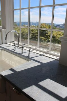 Window with a view over kitchen sink. Let NewGraniteMarble.com complete your next countertop project!