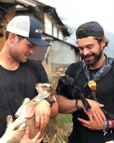 See Zac Efron and His Hot Brother Dylan Cradle Baby Goats in Their Arms!