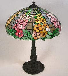 Tiffany lamps for sale lamps sale on tiffany lamps and lights wilkinson hollyhock table lamp stained glass aloadofball Image collections