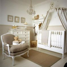 Monochromatic Nursery Sandy shades of beige ground the space while white trims and over-the-crib curtains maintain its charm. This nursery is pleasing to the eye thanks to monochromatic furniture and matching knickknacks —  a great gender-neutral option.Source: Chic Shack