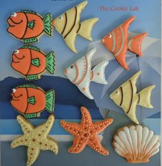 Fish cookies~                                By The Cookie Lab on Facebook, Orange fish, yellow Angel fish,